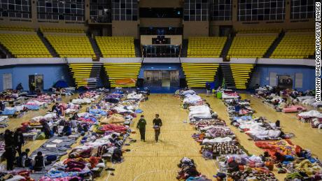Residents take shelter in a local stadium after an earthquake and aftershocks on February 7.