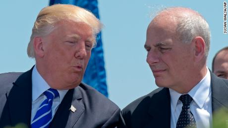 In this May 17, 2017, file photo, President Donald Trump talks with Homeland Security Secretary John Kelly during commencement exercises at the U.S. Coast Guard Academy in New London, Conn. Trump named Kelly as his new Chief of Staff on July 28, ousting Reince Priebus.