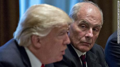 John Kelly, White House chief of staff, listens as U.S. President Donald Trump, left, speaks during a briefing with senior military leaders in the Cabinet Room of the White House in Washington, D.C., U.S., on Thursday, Oct. 5, 2017.