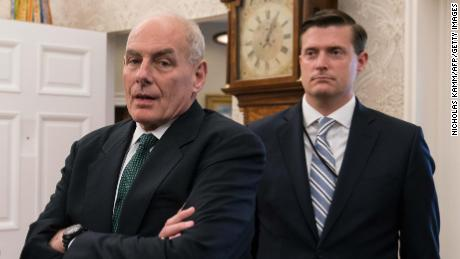 White House senior adviser Jared Kushner (L), White House chief of staff John Kelly (C) and White House staf secretary Rob Porter look on after US President Donald Trump signed a proclamation calling for a national day of prayer on September 3 for those affected by Hurricane Harvey in the Oval Office at the White House in Washington, DC, on September 1, 2017.