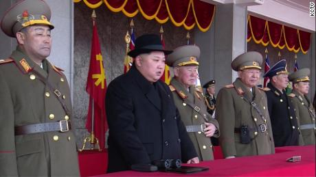 North Korean leader Kim Jong Un watches the February 8 military parade from a balcony.