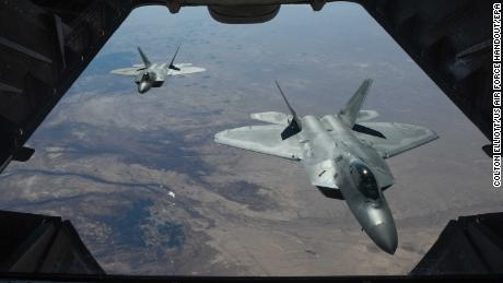 A handout photo made available by the US Department of Defense shows two US Air Force F-22 Raptors flying above Syria in support of Operation Inherent Resolve on Friday.