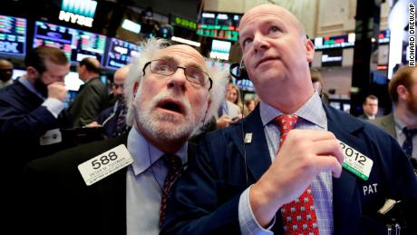 Dow plunges 1,000 points, sinks into correction