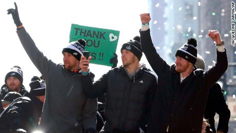 Philadelphia Eagles quarterbacks Nick Foles, left, Nate Sudfeld and Carson Wentz ride in the Eagles team parade.