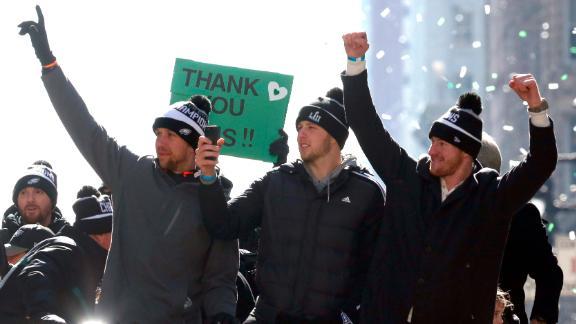 Philadelphia Eagles quarterbacks Nick Foles, left, Nate Sudfeld and Carson Wentz ride in the Eagles team parade.