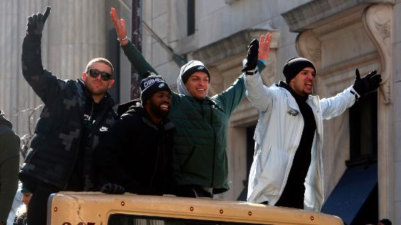 Eagles wide receivers Zach Ertz, left, and Mack Hollins, second from right, ride with teammates.