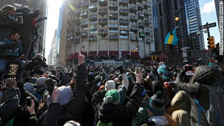 Fans celebrate with the Philadelphia Eagles during their NFL Super Bowl victory parade.