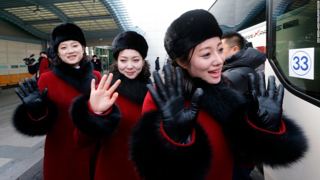 North Korean cheering squads wave upon arriving at the Korean-transit office near the Demilitarized Zone on February 7, 2018 in Paju, South Korea.
