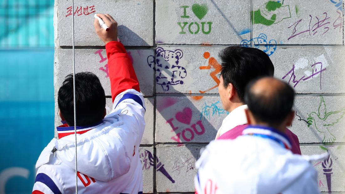 North Korea's Vice Sports Minister Won Gil-woo signs the Welcome Wall ahead of the PyeongChang 2018 Winter Olympic Games.