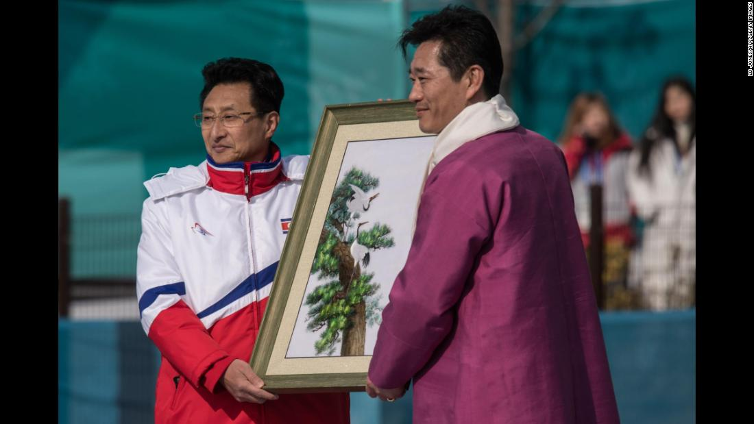 North Korea's Won Kil U offers a gift during a welcoming ceremony for North Korea's athletes.