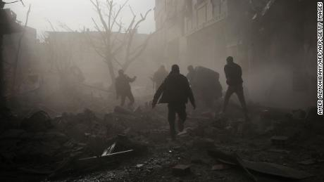 Syrians reacts following an air strike in the rebel-held enclave of Arbin in the  Eastern Ghouta near Damascus on February 8, 2018. The death toll from Syrian regime air strike on the rebel-held enclave of Eastern Ghouta near Damascus rose to 36, a monitor said. Ten children and seven women were among Thursday's victims, bringing to 185 the number of civilians killed since Monday, said Rami Abdel Rahman, head of the Britain-based Observatory / AFP PHOTO / Amer ALMOHIBANYAMER ALMOHIBANY/AFP/Getty Images