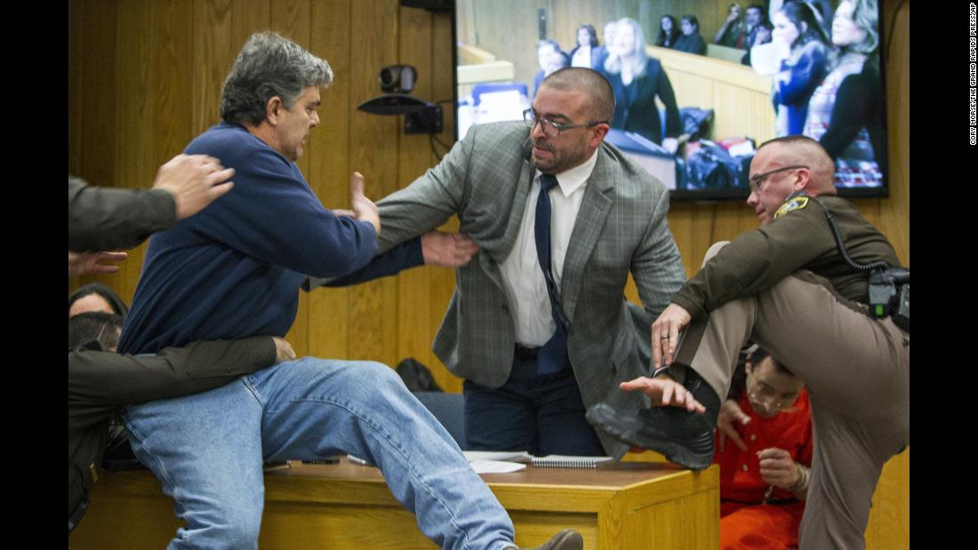 "Randall Margraves, left, <a href=""http://www.cnn.com/2018/02/02/us/larry-nassar-attack-court/index.html"" target=""_blank"">lunges at Larry Nassar</a>, bottom right, during Nassar's third and final sentencing hearing in Charlotte, Michigan, on Friday, February 2. Margraves, the father of three daughters who say they were abused by Nassar, tried to attack Nassar -- the former doctor for USA Gymnastics and Michigan State University -- in an Eaton County, Michigan, courtroom before Margraves was tackled and detained by security. Margraves was brought back into the court in handcuffs during a lunch break, and he apologized to the court."