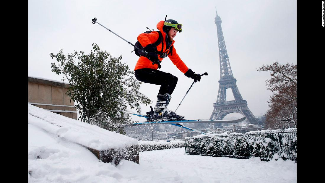 "A man skis at a snow-covered Trocadero Square in front of the Eiffel Tower in Paris on Wednesday, February 7. The Eiffel Tower was shuttered to tourists as <a href=""http://www.cnn.com/2018/02/07/europe/paris-snow-eiffel-tower-intl/index.html"" target=""_blank"">heavy snowfall snarled traffic in Paris</a>, bringing the city to a standstill on Wednesday. According to the Meteo France weather service, up to 5.9 inches of snow had fallen in the Paris area -- the biggest snowfall since 1987."