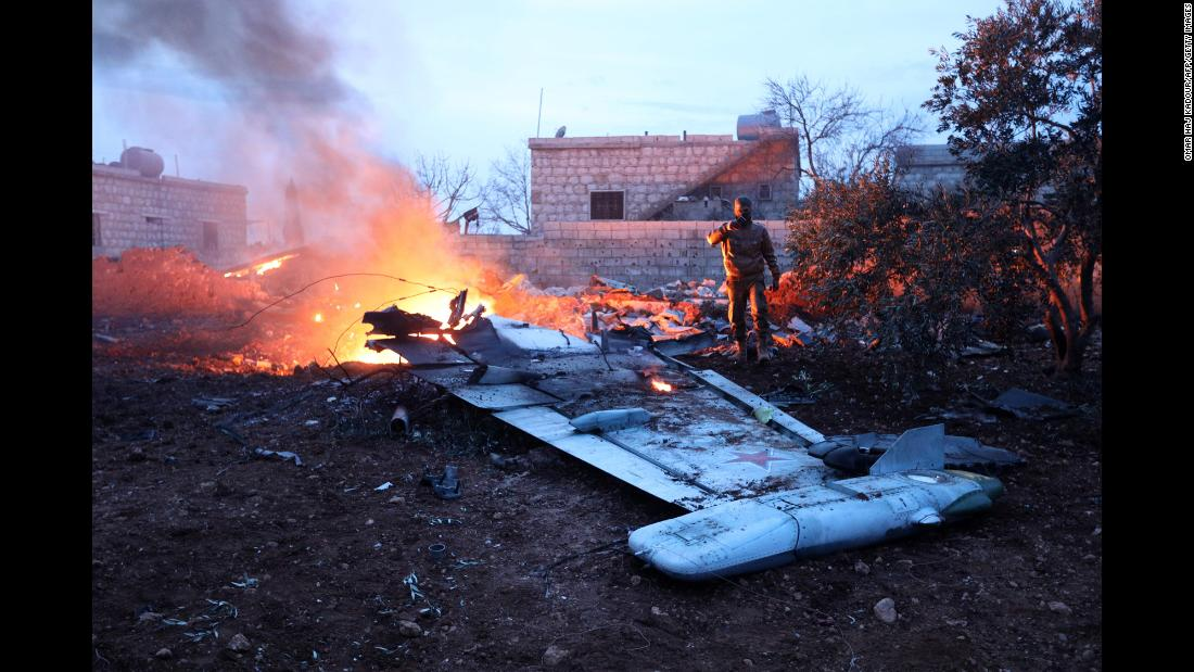 "A rebel fighter takes a picture of a downed Russian Su-25 warplane in Syria's northwest province of Idlib on Saturday, February 3. <a href=""http://www.cnn.com/2018/02/03/middleeast/russian-plane-shot-down-syria/index.html"" target=""_blank"">Militants shot down the plane</a> in an area controlled by al-Nusra Front fighters, according to a RIA Novosti report. The Russian defense ministry said the pilot was able to eject from the aircraft before it crashed, according to state-run news agency TASS, but died while fighting al-Nusra fighters."
