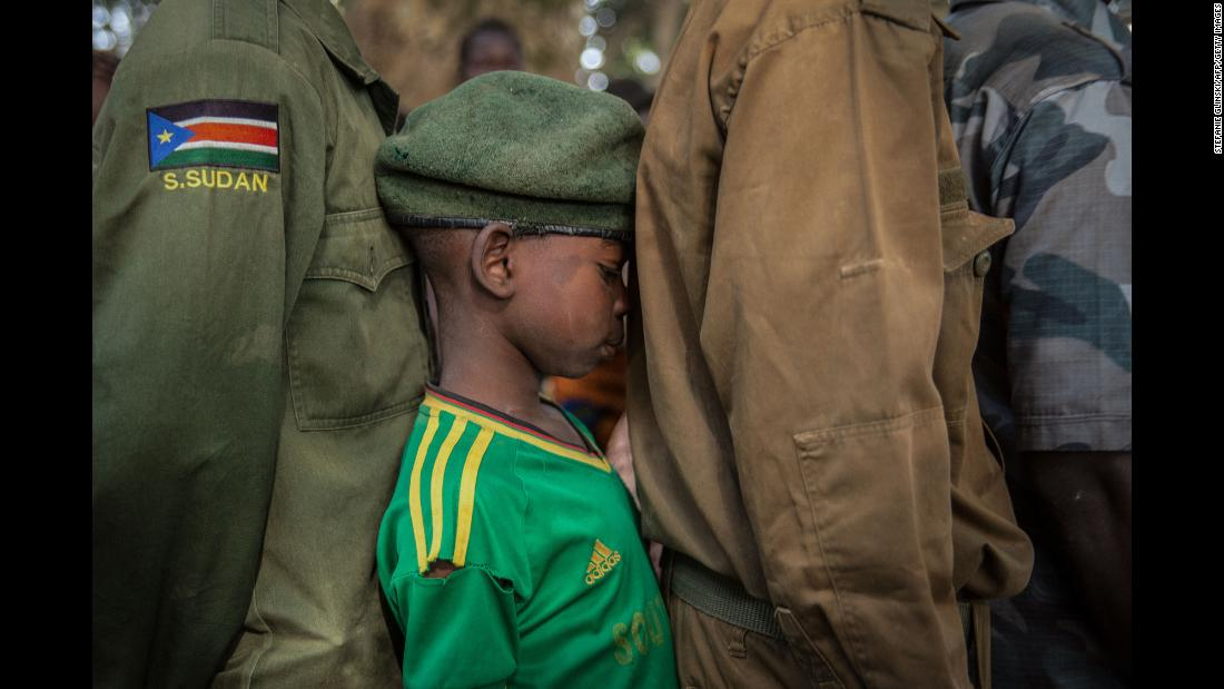 "Newly released child soldiers wait in a line for their registration during a release ceremony in Yambio, South Sudan, on Wednesday, February 7. <a href=""https://unmiss.unmissions.org/unmiss-welcomes-release-hundreds-former-child-soldiers-yambio"" target=""_blank"">The United Nations reported</a> ""more than 300 child soldiers were officially released by armed groups in Yambio to begin reintegrating into their communities and learning new skills to support themselves."""