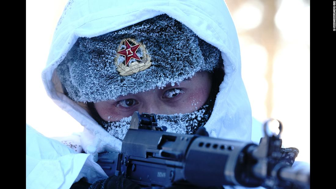 A soldier takes part in a training exercise in Beiji Village on the border county of Mohe, northeast China, on Friday, February 5.