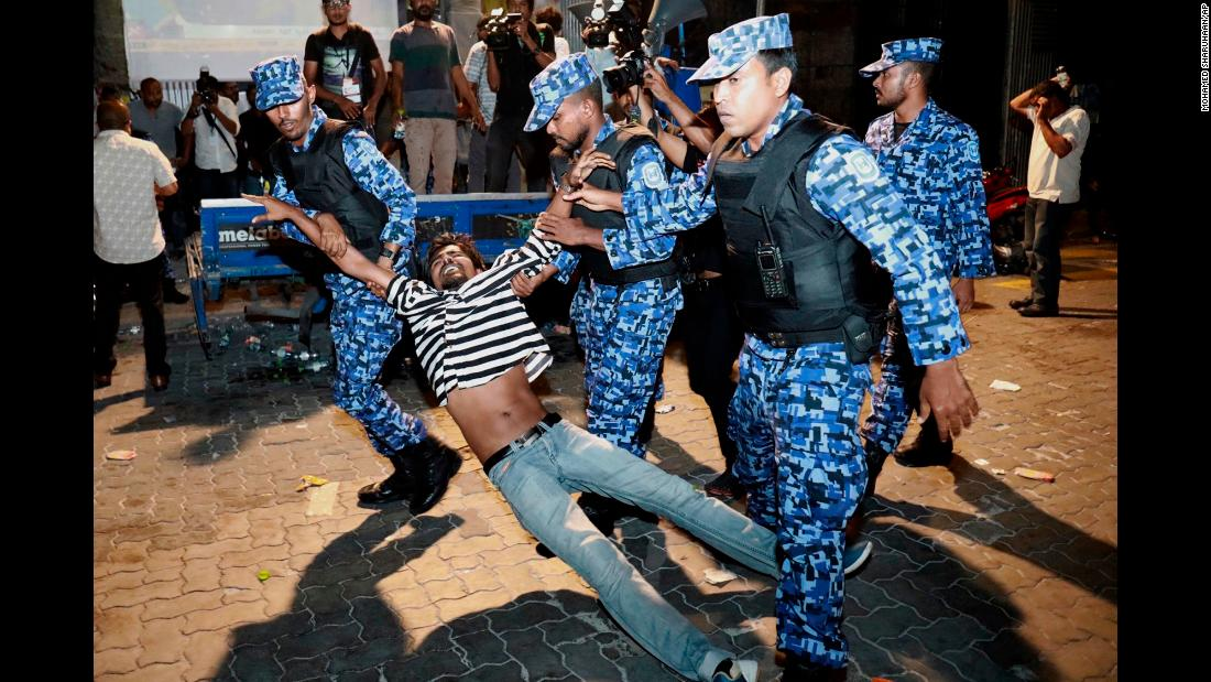 "Police detain a protester demanding the release of political prisoners during a demonstration in Malé, Maldives, on Friday, February 2. <a href=""http://www.cnn.com/2018/02/06/asia/maldives-political-unrest-explainer-intl/index.html"" target=""_blank"">What's happening in the Maldives? All you need to know</a>"