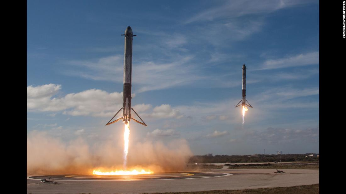 "SpaceX Falcon Heavy booster rockets return to land after lifting a demonstration payload into space at Kennedy Space Center in Cape Canaveral, Florida, on Tuesday, February 6. SpaceX <a href=""http://money.cnn.com/2018/02/06/technology/future/spacex-falcon-heavy-launch-mainbar/index.html"" target=""_blank"">successfully launched Falcon Heavy</a>, the world's most powerful rocket. <a href=""http://www.cnn.com/2018/02/02/world/gallery/week-in-photos-0202/index.html"" target=""_blank"">See last week in 37 photos</a>"