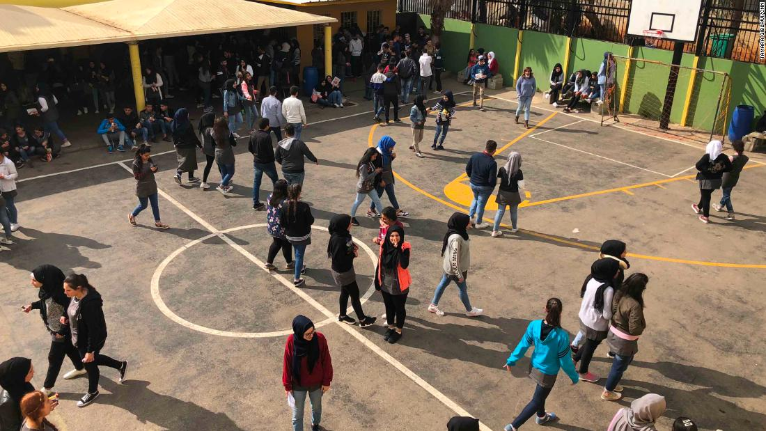 Students spend their recess at the school's basketball court.