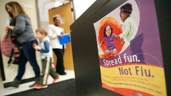 An information poster for the flu hangs in a Dekalb County health center in Decatur, Ga., Monday, Feb. 5, 2018. The U.S. government's latest flu report released on Friday, Feb. 2, 2018, showed flu season continued to intensify the previous week, with high volumes of flu-related patient traffic in 42 states, up from 39 the week before. (AP Photo/David Goldman)