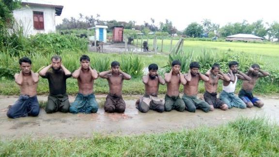 Ten Rohingya Muslim men with their hands bound kneel in Inn Din village September 1, 2017.