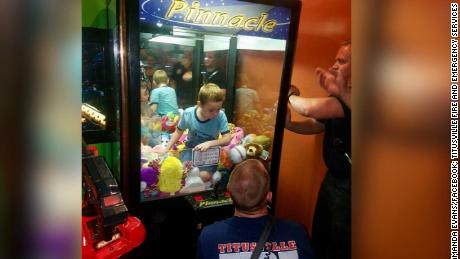 NS Slug: FL: BOY GETS TRAPPED IN ARCADE CLAW MACHINE  Synopsis: Boy rescued after getting stuck inside toy claw machine  Keywords: FLORIDA SOUTH EAST RESTAURANT FOOD FIRE FIGHTER RESCUE