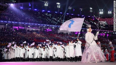 North and South Korea marched together at the Olympics opening ceremony under a unified flag.