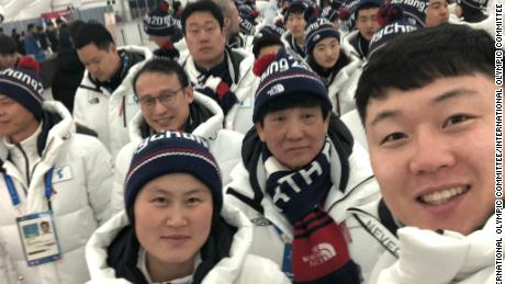 Athletes from North and South Korea pose for a selfie