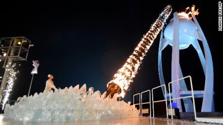 South Korean Olympic figure skating champion Yuna Kim lights the Olympic flame.