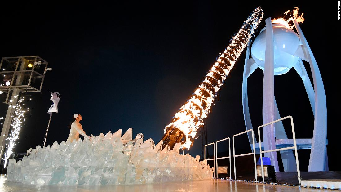 Former figure skater Kim Yuna lights the Olympic cauldron. The South Korean won gold in the 2010 Winter Olympics.