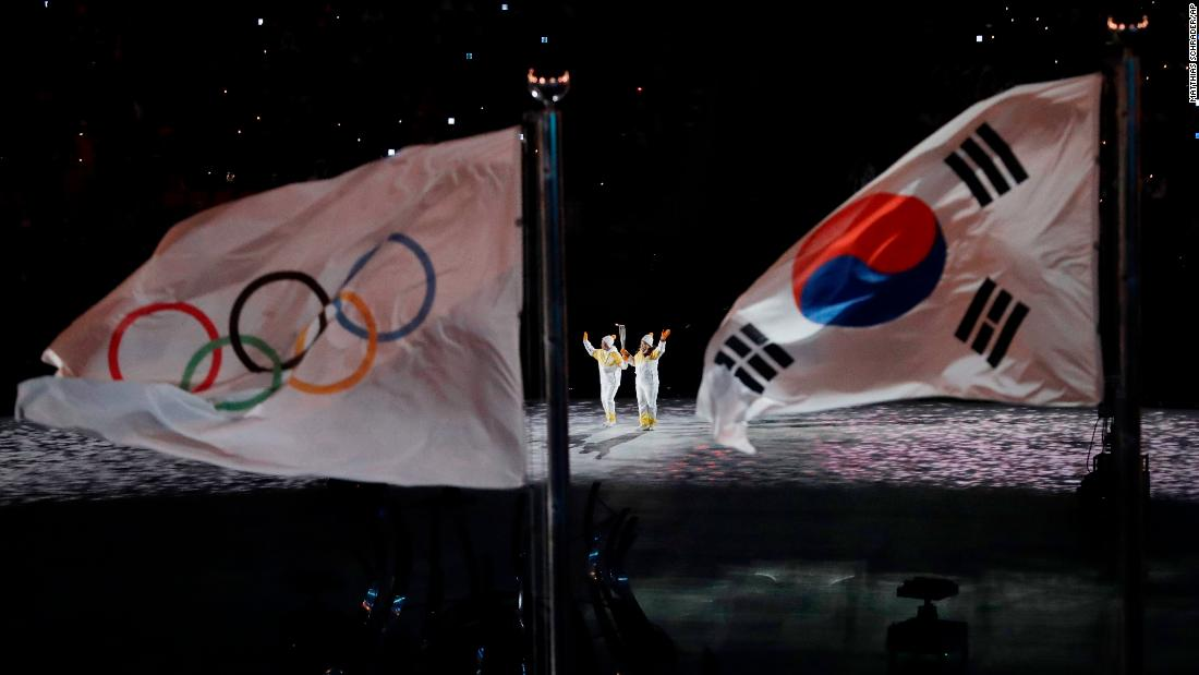 "The Olympic torch is carried into a stadium in Pyeongchang, South Korea, during <a href=""http://www.cnn.com/2018/02/09/sport/gallery/opening-ceremony-winter-olympics/index.html"" target=""_blank"">the opening ceremony</a> on Friday, February 9. <a href=""http://www.cnn.com/interactive/2018/02/sport/winter-olympics-cnnphotos/index.html"" target=""_blank"">See the best photos of the 2018 Winter Olympics</a>"