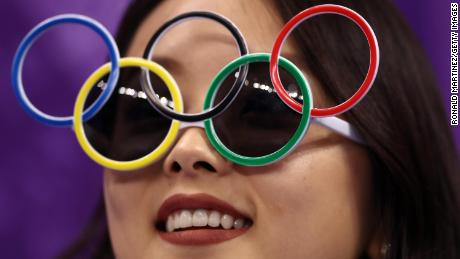 GANGNEUNG, SOUTH KOREA - FEBRUARY 09:  A fan looks on wearing Olympic Rings glasses in the Figure Skating Team Event - Men's Single Skating Short Program during the PyeongChang 2018 Winter Olympic Games at Gangneung Ice Arena on February 9, 2018 in Gangneung, South Korea.  (Photo by Ronald Martinez/Getty Images)