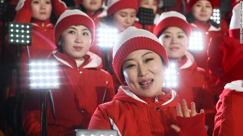 Members of the North Korean cheering band wave ahead of the opening ceremony of the Pyeongchang 2018 Winter Olympic Games at the Pyeongchang Stadium on February 9, 2018.