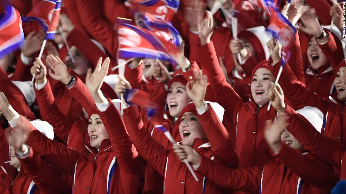North Korean cheerleaders wave their country's flag as they gather ahead of the opening ceremony.