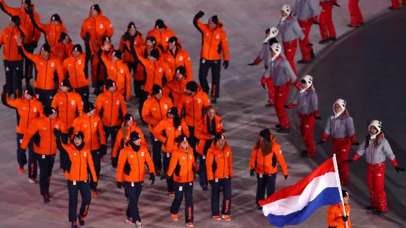 Dutch athletes enter the stadium.