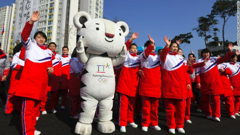 North Korean athletes take part in a welcoming ceremony for the team at the Olympic Village in Gangneung on February 8.