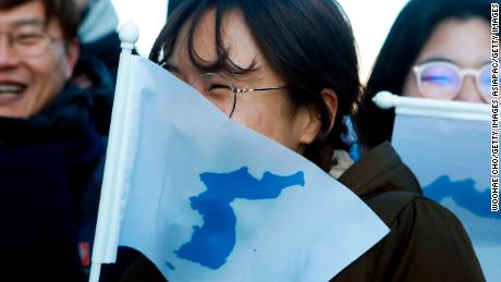 INCHEON, SOUTH KOREA - FEBRUARY 04:  South Korean peace activists carry the Flag of Korean Peninsula before the Women's Ice Hockey friendly match at Seonhak International Ice Rink on February 4, 2018 in Incheon, South Korea. The friendly match is held ahead of the Olympic Games where South and North Korea competes for the first time as a unified team in a sport at the Olympic Games.  (Photo by Woohae Cho/Getty Images)