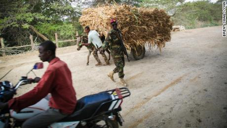 A Somali soldier guards a checkpoint just outside of Afgoye. The route beyond the town remains in the hands of al-Shabaab.