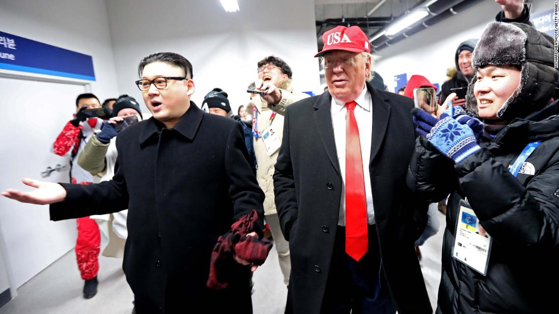 Impersonators of Kim Jong Un and US President Donald Trump are escorted out of the stadium.