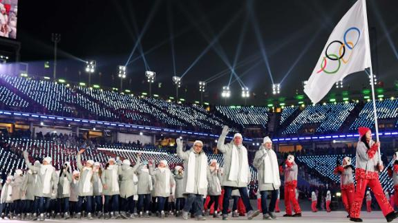 """Olympic athletes from Russia march under a neutral flag. Russia was banned from taking part in the Games after the International Olympic Committee found that the country had engaged in """"systemic manipulation"""" of anti-doping rules."""