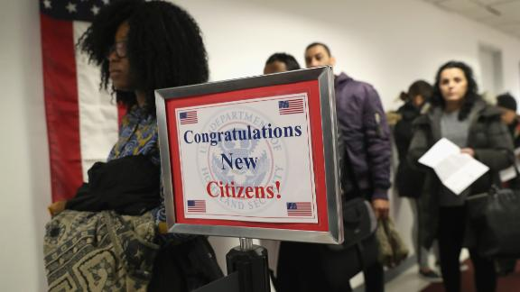 NEW YORK, NY - FEBRUARY 02:  Immigrants wait in line to become U.S. citizens at a naturalization ceremony on February 2, 2018 in New York City. U.S. Citizenship and Immigration Services (USCIS) swore in 128 immigrants from 42 different countries during the ceremony at the downtown Manhattan Federal Building.  (Photo by John Moore/Getty Images)