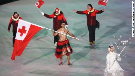 Flag bearer Pita Taufatofua of Tonga leads the team during the opening ceremony.