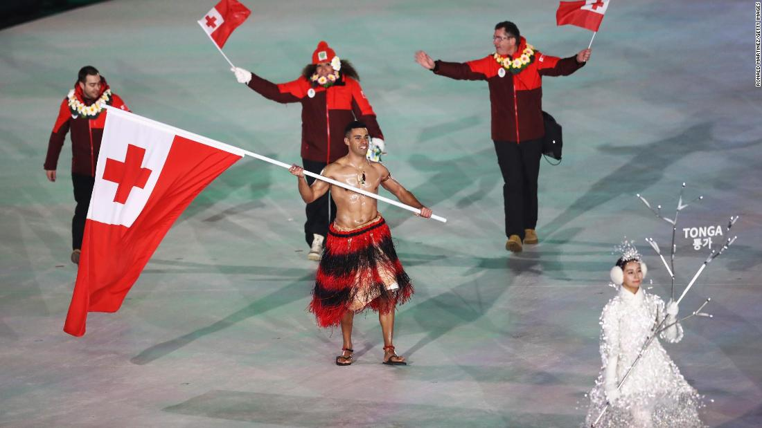 Tongan flag bearer Pita Taufatofua goes shirtless, as he did for the opening ceremony of the 2016 Summer Olympics.