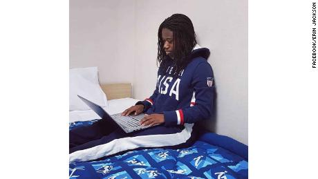 Long track speed skater Erin Jackson of Team USA watches the opening ceremony on her laptop.