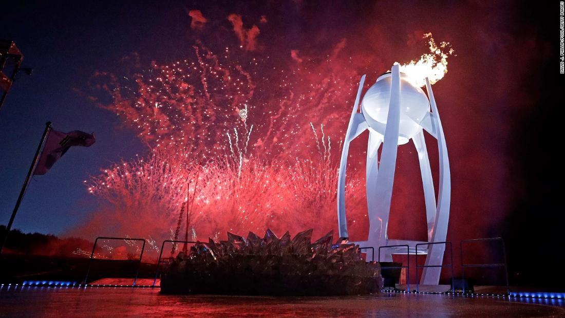 Fireworks erupt as the Olympic cauldron is lit in Pyeongchang, South Korea, on Friday, February 9.