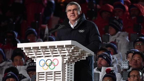 Thomas Bach, the president of the International Olympic Committee, speaks before the lighting of the cauldron.