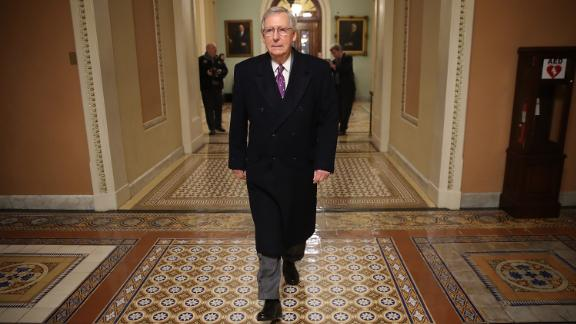 WASHINGTON, DC - FEBRUARY 08:  Senate Majority Leader Mitch McConnell (L) (R-KY) returns to the U.S. Capitol just before midnight February 8, 2018 in Washington, DC.  (Win McNamee/Getty Images)