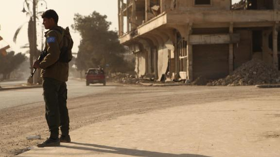 Members of the newly formed RISF or Raqqa Internal Security Force stand guard on a street. This newly formed force falls under the jurisdiction of the civilian administration of Raqqa and is meant to function like a police force.