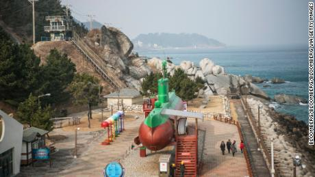 Visitors walk past a  North Korean Sang-O class submarine, which stranded on South Korean waters in 1996. It is now on display at Tongil Park in Gangneung, Gangwon, South Korea
