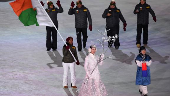 Flag bearer Mialitiana Clerc of Madagascar leads the team at the opening ceremony. She was born in Madagascar but learnt to ski in France and is the first woman to compete for the country in alpine skiing.